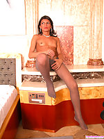 Spicy shemale playing with her hard-on till jazzing on her grey pantyhose