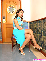 Innocent looking shemale revealing her stiff surprise with her pantyhose on
