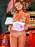 Tanned chick in flesh-colored pantyhose fondling her pussy near bar counter