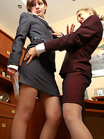 Lusty secretary in sheer pantyhose getting kicks from lesbian games at work