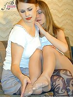 Wanting tender lesbians in exotic pantyhose fondling each other