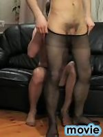 Lewd gay guy in silky pantyhose getting orally and anally used on the sofa