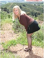 Skirt Lifted In A Field On A Hillside With Sheer Black Pantyhose
