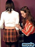 Tranny schoolgirl in black stockings gets spanked by Mistress Jane