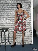 Jane in a hot floral dress bends over and shows off legs