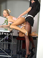 French maid seducing her maid friend into hot pantyhose action on the table