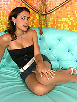 Sexy shemale stripping her skimpy outfit and posing in her smooth pantyhose