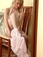 Awakening blonde fitting her sheer white stockings to her fine lacy garter
