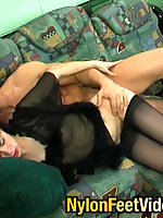 Redhead chick in black pantyhose giving footjob after steamy pussy-cramming