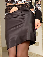 Blonde gal peels off her black full-fashioned stockings and high heel shoes