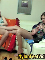 Lesbian chicks taking pleasure from foot-licking with their pantyhose on