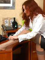 Secretary teases with her upskirt look changing black nylons for grey ones