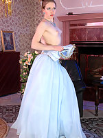 Sexy bride strips her blue wedding dress revealing barely visible stockings