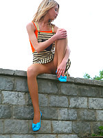 Mischievous blonde babe teasing with her barely visible pantyhose outdoors