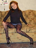 Leggy Blondie in black nylon pantyhose exhibiting herself on  sofa.