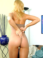 Awesome blonde chick pulling on her flesh-colored pantyhose in weird way
