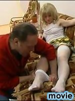 Horny blondie in white stockings surrenders to breathtaking fucking on sofa