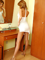 Pantyhosed chick with sell-shaped body fitting extremely seducing dresses