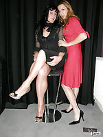 Jane and sexy tgirl caress each others stocking covered legs