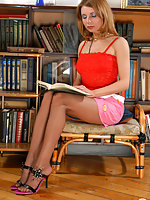 Cute gal in suntan pantyhose eagerly showing what she hides under her skirt