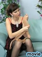 Naughty chick caressing her wet pussy with the hand clad in nylon pantyhose