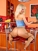 Sultry blonde gal in sheer pantyhose stroking herself from toes to her pink