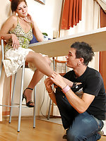 Cutie in lacy tights giving footjob after frenzied foot-licking at the cafe