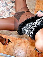 Smashing brunette chick in black pantyhose ready for steamy dancing show