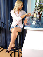 Lascivious blonde chick in sheer pantyhose smoking in extremely sexy way
