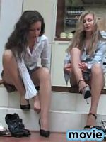 Lesbian chick pushing the tits putting to work her feet in silky pantyhose