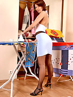 Redhead chick stops ironing craving to play pantyhose games right on floor