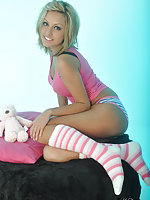 Stunning little blonde bombshell wearing knee high socks and cheeky panties