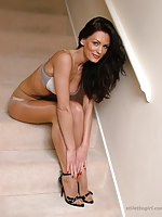 Stunning skinny babe Eva shows off her sexy smarting legs and hot body in silky pantyhose and high heels