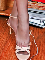 Vivacious chick creaming her delicious feet clad in grey luxury pantyhose