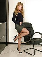 Long-legged Kathryn shows the brush gorgeous black nylon legs and tall shiny stilettos, as she struts around the assignation