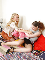Hotties in black shoes playing with cushions before stroking nyloned feet