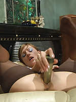 Outrageously hot chick rubbing her beloved sex toy against her nyloned feet