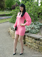 Cute brunette Elise works on your talisman debilitating a tight pink summer dress and shiny black stilettos
