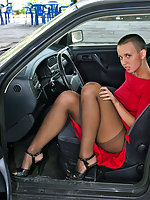 Extremely hot chick posing in her black control top pantyhose right in car