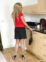 Hot babe Kathryn is teasing in the air the kitchen in the air shiny sinister heels and silky nylons