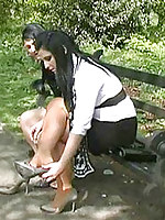 High heel crippling beauties switch shoes while they walk outside