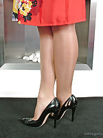 A sexy red dress and beautiful black high heel stilettos