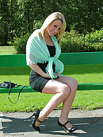 Cheeeky blonde Hannah is wearing her sexy high heels outdoors in the sunshine