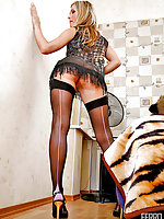 Awesome chick demonstrating her shapely legs in full-fashioned stockings