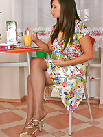 Luscious chick in grey tights pampering her long legs right on the stool