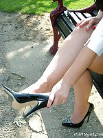 Horny stiletto girl shows off her black high heels outdoors