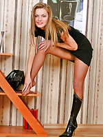Nasty gal taking off her black boots and caressing her well-maintained feet