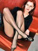 Redhead chick just thinking about posing in her extremely sexy pantyhose