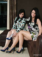 Two hot babes play with each others glum spiked heels
