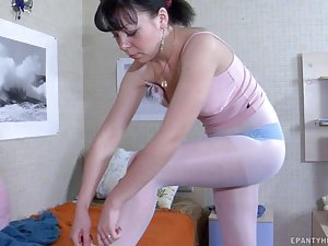 Gorgeous girlie fits on her white control top pantyhose after a sweet sleep